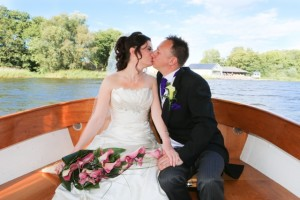 Lee & Pinar kissing on boat