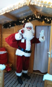 Santa outside grotto with sack edit 1 2014